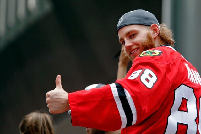 Jun 18, 2015; Chicago, IL, USA; Chicago Blackhawks right wing Patrick Kane (88) gives a thumbs up to the crowd during the 2015 Stanley Cup championship parade and rally at Soldier Field. (Jon Durr ...
