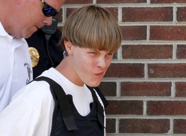 Police lead suspected shooter Dylann Roof, 21, into the courthouse in Shelby, North Carolina, June 18, 2015.  Roof, 21, is accused of killing nine people at a Bible-study meeting in a historic Afr ...