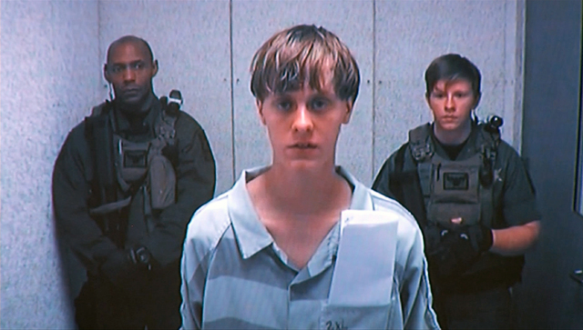 Dylann Storm Roof appears by closed-circuit television at his bond hearing in Charleston, South Carolina, June 19, 2015, in a still image from video.  (Reuters/Pool)