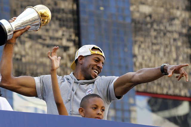 Jun 19, 2015; Oakland, CA, USA; Golden State Warriors guard Andre Iguodala acknowledges fans during the Golden State Warriors 2015 championship celebration in downtown Oakland. (Cary Edmondson-USA ...