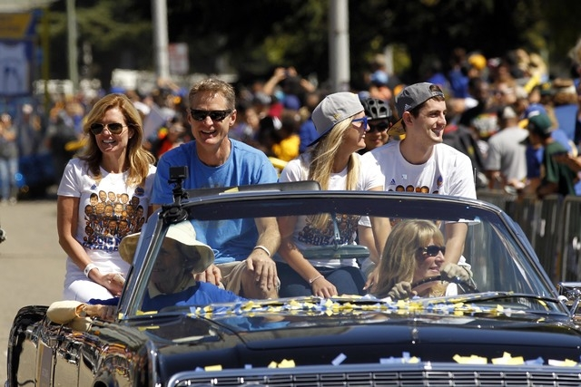 Jun 19, 2015; Oakland, CA, USA; Golden State Warriors head coach Steve Kerr rides in a convertible during the Golden State Warriors 2015 championship celebration in downtown Oakland. (Cary Edmonds ...