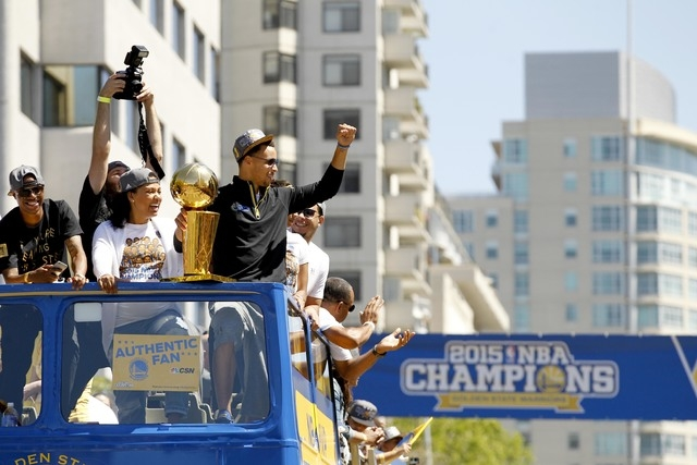 Jun 19, 2015; Oakland, CA, USA; Golden State Warriors guard Stephen Curry acknowledges fans during the Golden State Warriors 2015 championship celebration in downtown Oakland. (Cary Edmondson-USA  ...