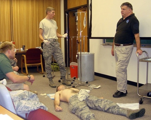 Dr. John Hagmann, right, teaches a course in treating battlefield trauma in 2010. The photo was released on June 17, 2015. (Reuters/handout)
