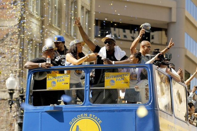 Jun 19, 2015; Oakland, CA, USA; Golden State Warriors forward Draymond Green rides on a double decker bus with Seattle Seahawks running back Marshawn Lynch (second from left) during the Golden Sta ...
