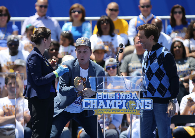 Jun 19, 2015; Oakland, CA, USA; Oakland mayor Libby Schaaf presents Golden State Warriors owners Joe Lacob and Peter Guber with the key to the city during the Golden State Warriors 2015 championsh ...