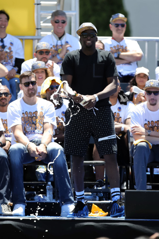 Jun 19, 2015; Oakland, CA, USA; Golden State Warriors forward Draymond Green (23) sprays champagne during the Golden State Warriors 2015 championship celebration at the Henry J. Kaiser Convention  ...