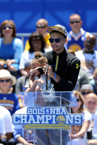 Jun 19, 2015; Oakland, CA, USA; Riley Curry gets stage fright with father guard Stephen Curry (30) during the Golden State Warriors 2015 championship celebration at the Henry J. Kaiser Convention  ...