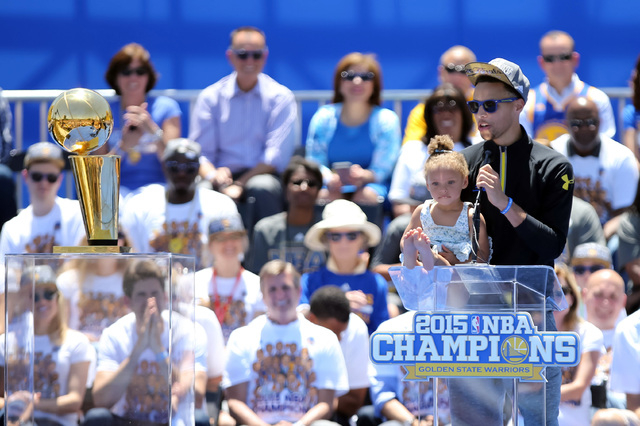 Jun 19, 2015; Oakland, CA, USA; Golden State Warriors guard Stephen Curry (30) speaks with daughter Riley on the podium during the Golden State Warriors 2015 championship celebration at the Henry  ...