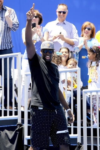 Jun 19, 2015; Oakland, CA, USA; Golden State Warriors forward Draymond Green acknowledges the crowd during the Golden State Warriors 2015 championship celebration in downtown Oakland. (Cary Edmond ...