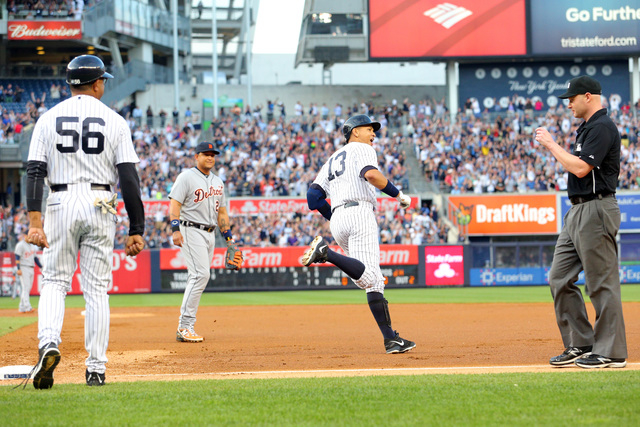 Jun 19, 2015; Bronx, NY, USA; New York Yankees designated hitter Alex Rodriguez (13) rounds the bases past first base coach Tony Pena (56) and Detroit Tigers first baseman Miguel Cabrera (24) and  ...