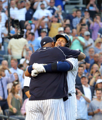 Jun 19, 2015; Bronx, NY, USA; New York Yankees designated hitter Alex Rodriguez (13) hugs New York Yankees starting pitcher CC Sabathia (52) at home after hitting a solo home run against the Detro ...
