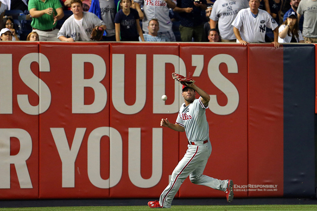 Jun 23, 2015; Bronx, NY, USA; Philadelphia Phillies right fielder Jeff Francoeur (3) makes an error on a ball hit by New York Yankees third baseman Chase Headley (12) during the sixth inning of an ...