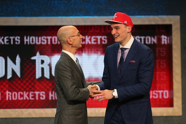 Jun 25, 2015; Brooklyn, NY, USA; Sam Dekker (Wisconsin) greets NBA commissioner Adam Silver after being selected as the number eighteen overall pick to the Houston Rockets in the first round of th ...