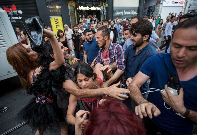 LGBT rights activists struggle with plainclothes police officers before a Gay Pride Parade in central Istanbul, Turkey, June 28, 2015. (Huseyin Aldemir/Reuters)
