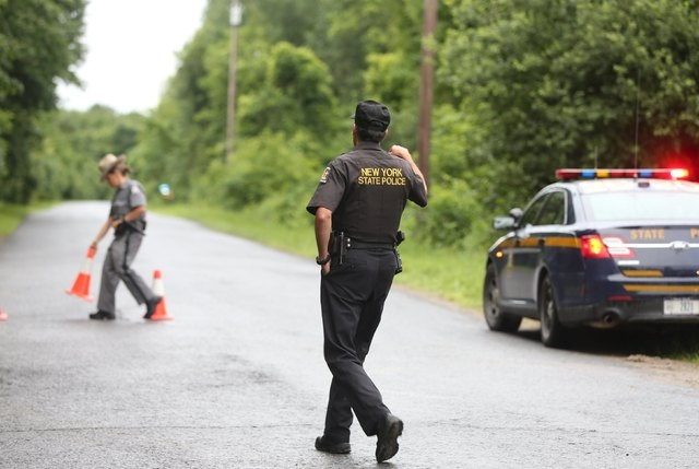 State police block Coveytown Road, about one mile from where escaped prisoner David Sweat was captured in Constable, New York, June 28, 2015. David Sweat, one of two New York state inmates who esc ...