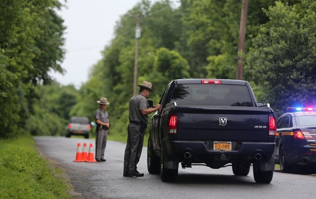 State troopers allow residents down Coveytown Road, about one mile from where escaped prisoner David Sweat was captured, in Constable, New York, June 28, 2015. Sweat, one of two New York state inm ...