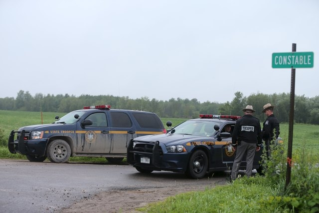 State troopers block Coveytown Road, about one-quarter mile (400 m) from where escaped prisoner David Sweat was captured in Constable, New York, June 28, 2015. Sweat, one of two New York state inm ...