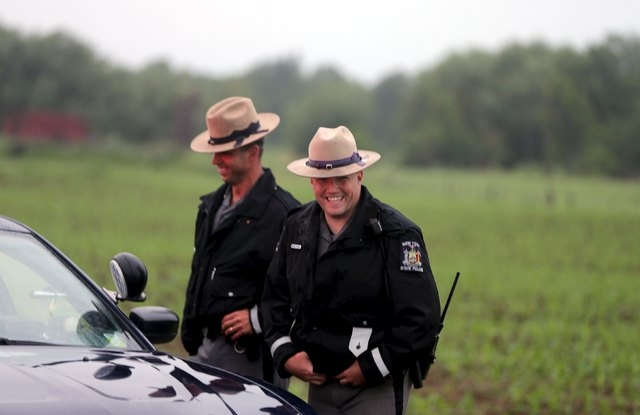 State troopers block Coveytown Road, about one-quarter mile (400 m) from where escaped prisoner David Sweat was captured, in Constable, New York, June 28, 2015. Sweat, one of two New York state in ...