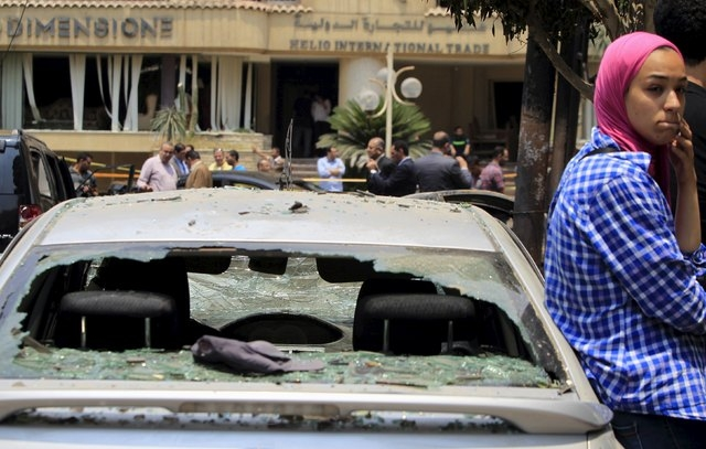A car damaged as a result of a car bomb attack on the convoy of Egyptian public prosecutor Hisham Barakat near his house at Heliopolis district, is seen in Cairo, Egypt, June 29, 2015.  Barakat di ...