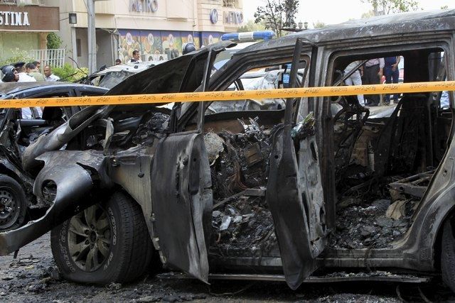 A car damaged as a result of a car bomb attack on the convoy of Egyptian public prosecutor Hisham Barakat near his house at Heliopolis district is seen in Cairo June 29, 2015. Barakat died from wo ...