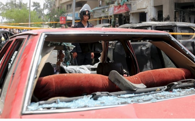 A car damaged as a result of a car bomb attack on the convoy of Egyptian public prosecutor Hisham Barakat near his house at Heliopolis district, is seen in Cairo, June 29, 2015. Barakat died from  ...