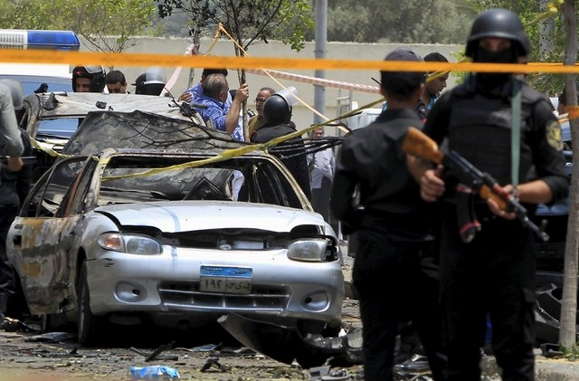 Policemen secure the site of a car bomb attack on the convoy of Egyptian public prosecutor Hisham Barakat near his house at Heliopolis district in Cairo, June 29, 2015. (Mohamed Abd El Ghany/Reuters)