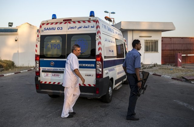 An ambulance carrying British tourists, who were wounded during the Imperial Marhaba hotel attack by a gunman, arrive to board the Royal Air Force (RAF) jet at Monastir airport, Tunisia, June 29,  ...