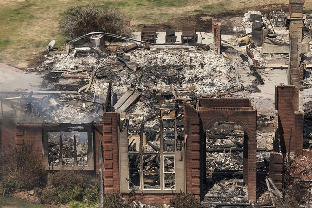 A home destroyed by the Sleepy Hollow fire is pictured in Wenatchee, Washington June 29, 2015.  A wildfire burning unchecked in central Washington state has destroyed at least 23 homes and three c ...