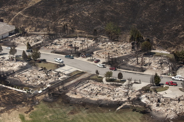 Homes destroyed by the Sleepy Hollow fire are pictured in Wenatchee, Washington June 29, 2015. (REUTERS/David Ryder)