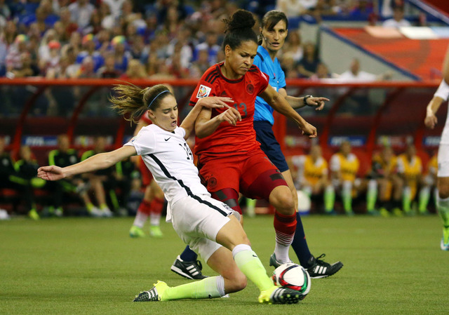 Jun 30, 2015; Montreal, Quebec, CAN; United States midfielder Morgan Brian (14) slides in front of Germany forward Celia Sasic (13) during the first half of the semifinals of the FIFA 2015 Women's ...