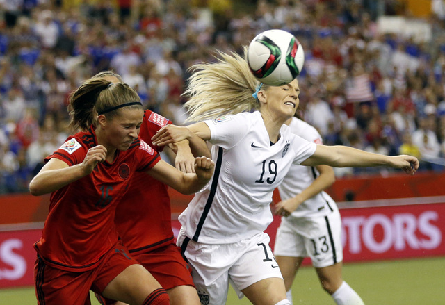 Jun 30, 2015; Montreal, Quebec, CAN; United States defender Julie Johnston (19) and Germany midfielder Melanie Leupolz (16) attempt a header during the first half of the semifinals of the FIFA 201 ...