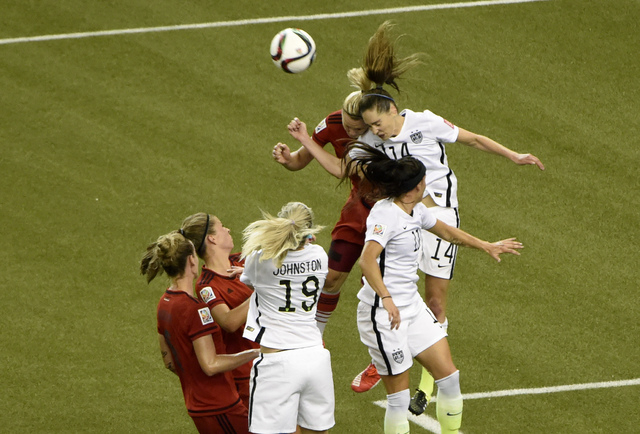 Jun 30, 2015; Montreal, Quebec, CAN; United States midfielder Morgan Brian (14) and Germany forward Alexandra Popp (18) collide attempting a header during the first half of the semifinals of the F ...