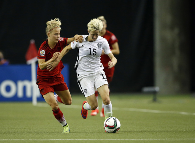 Jun 30, 2015; Montreal, Quebec, CAN; Germany defender Leonie Maier (4) defends against United States midfielder Megan Rapinoe (15) during the first half of the semifinals of the FIFA 2015 Women's  ...