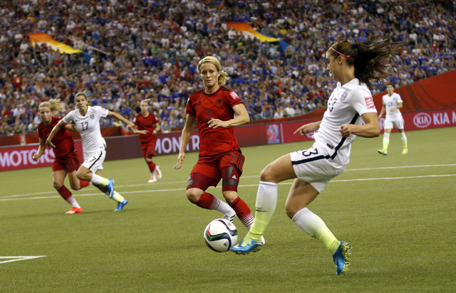 Jun 30, 2015; Montreal, Quebec, CAN; United States forward Alex Morgan (13) shoots against Germany defender Saskia Bartusiak (3) during the first half of the semifinals of the FIFA 2015 Women's Wo ...