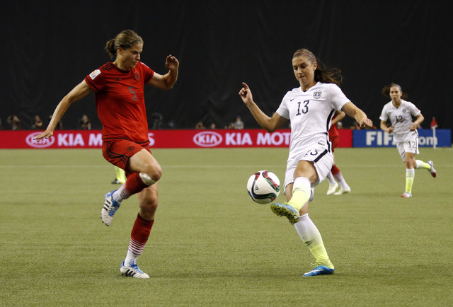 Jun 30, 2015; Montreal, Quebec, CAN; United States forward Alex Morgan (13) controls the ball against Germany defender Annike Krahn (5) during the first half of the semifinals of the FIFA 2015 Wom ...