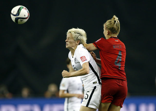 Jun 30, 2015; Montreal, Quebec, CAN; Germany defender Leonie Maier (4) fouls United States midfielder Megan Rapinoe (15) as they go up for the ball during the first half of the semifinals of the F ...