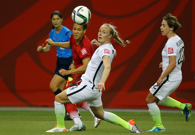 Jun 30, 2015; Montreal, Quebec, CAN; United States defender Becky Sauerbrunn (4) watches the the ball while defended by Germany forward Celia Sasic (13) during the first half of the semifinals of  ...