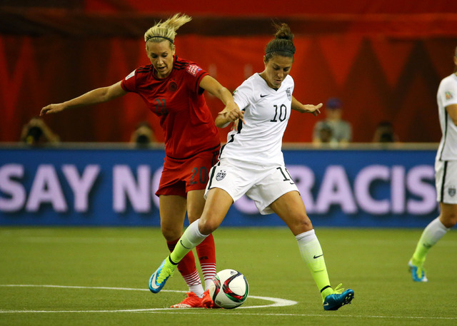 Jun 30, 2015; Montreal, Quebec, CAN; United States forward Carli Lloyd (10) and Germany midfielder Lena Goessling (20) battle for the ball during the first half of the semifinals of the FIFA 2015  ...
