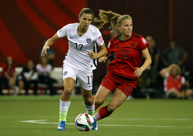 Jun 30, 2015; Montreal, Quebec, CAN; United States midfielder Tobin Heath (17) plays the ball while defended by Germany defender Tabea Kemme (22) during the first half of the semifinals of the FIF ...