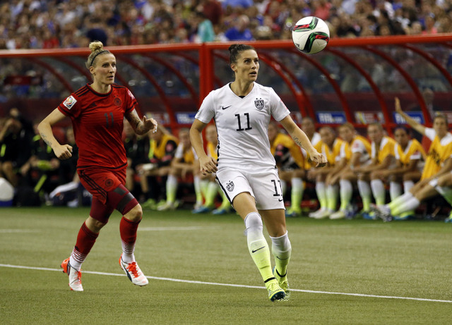 Jun 30, 2015; Montreal, Quebec, CAN; United States defender Alex Krieger (11) eyes the ball against Germany forward Anja Mittag (11) during the second half of the semifinals of the FIFA 2015 Women ...