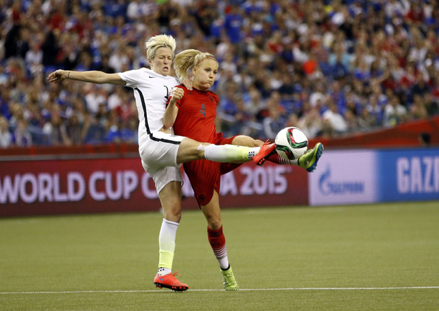 Jun 30, 2015; Montreal, Quebec, CAN; United States midfielder Megan Rapinoe (15) and Germany defender Leonie Maier (4) play the ball during the second half of the semifinals of the FIFA 2015 Women ...