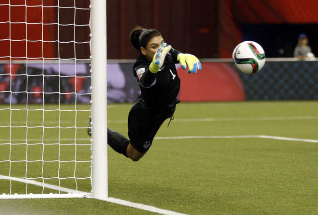 Jun 30, 2015; Montreal, Quebec, CAN; United States goalkeeper Hope Solo (1) makes a save against Germany during the second half of the semifinals of the FIFA 2015 Women's World Cup at Olympic Stad ...