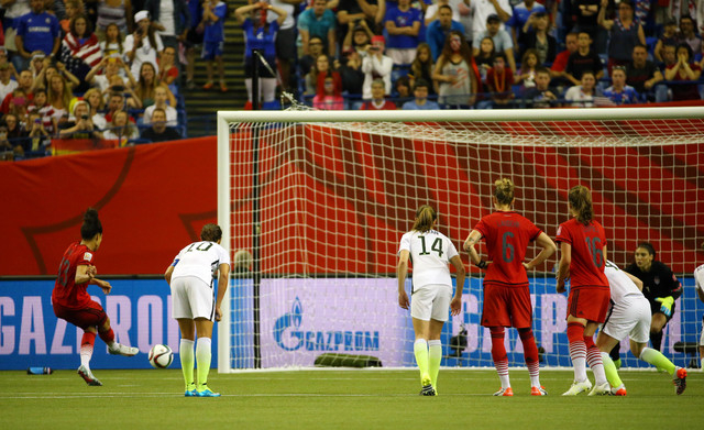 Jun 30, 2015; Montreal, Quebec, CAN; Germany forward Celia Sasic (13) takes a shot on goal against the United States during the second half of the semifinals of the FIFA 2015 Women's World Cup at  ...
