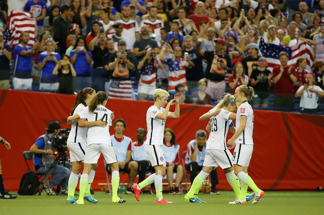 Jun 30, 2015; Montreal, Quebec, CAN; United States team members celebrate a goal by forward Carli Lloyd (10, not pictured) during the second half against Germany in the semifinals of the FIFA 2015 ...