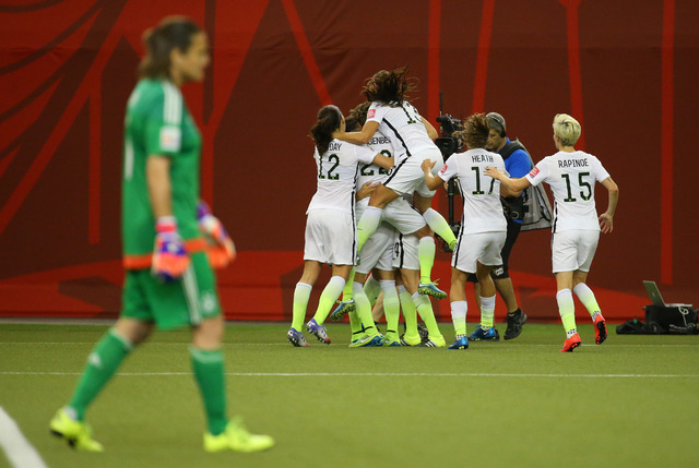 Jun 30, 2015; Montreal, Quebec, CAN; Germany goalkeeper Nadine Angerer (1) in the foreground as United States team members celebrate a goal during the second half against the United States in the  ...