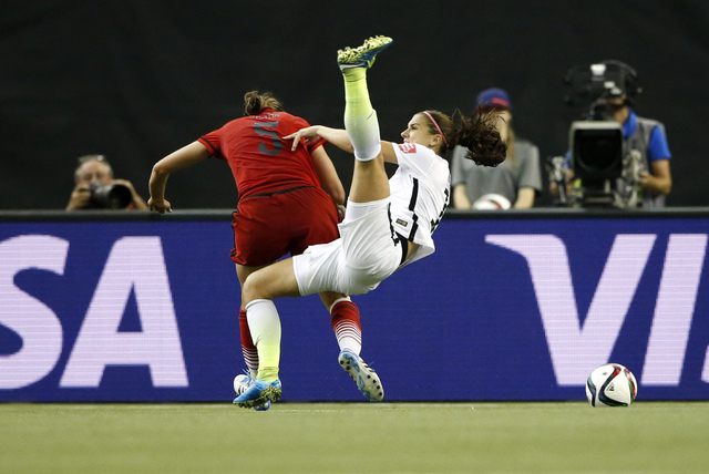 Jun 30, 2015; Montreal, Quebec, CAN; United States forward Alex Morgan (13) is fouled by Germany defender Annike Krahn (5) during the second half of the semifinals of the FIFA 2015 Women's World C ...