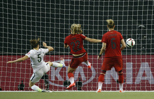 Jun 30, 2015; Montreal, Quebec, CAN; United States defender Kelley O'Hara (5) scores against Germany during the second half of the semifinals of the FIFA 2015 Women's World Cup at Olympic Stadium. ...