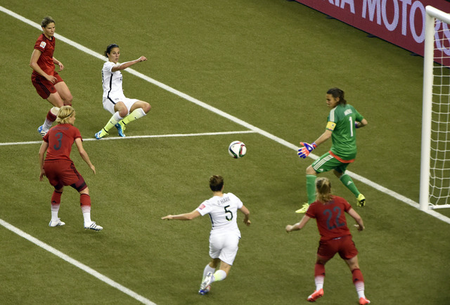 Jun 30, 2015; Montreal, Quebec, CAN; United States midfielder Carli Lloyd (10) passes to defender Kelley O'Hara (5) and O'Hara scores against Germany goalkeeper Nadine Angerer (1) during the secon ...