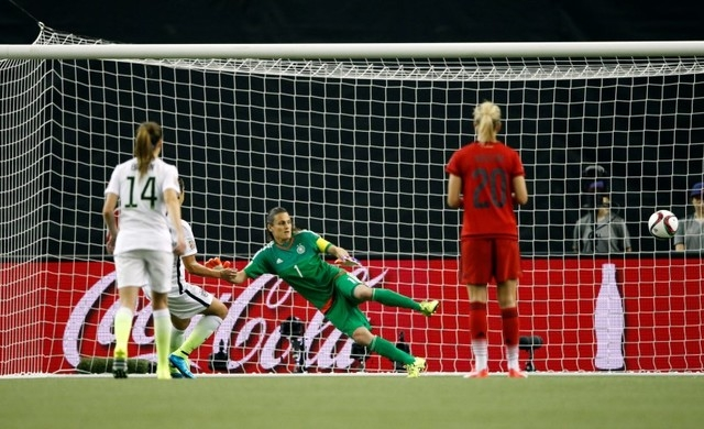 Jun 30, 2015; Montreal, Quebec, CAN; United States midfielder Carli Lloyd (10) scores on a penalty kick against Germany goalkeeper Nadine Angerer (1) during the second half of the semifinals of th ...
