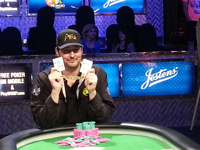 Phil Hellmuth poses with the 10 and 4 of spades to represent his 14th career World Series of Poker bracelet. Hellmuth, the all-time record holder, won the $10,000 buy-in Razz Championship late Mon ...